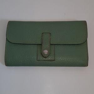 Dooney and bourke wallet with pen.